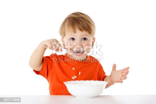 istock Cute baby eating oatmeal with spoon 162272938