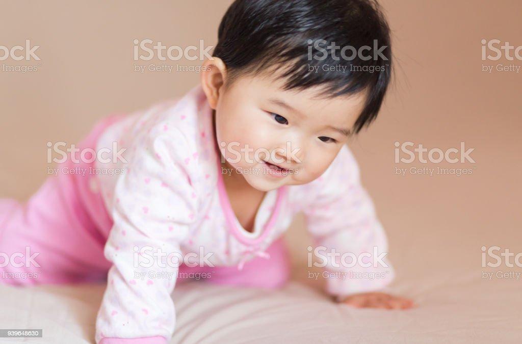 Cute baby effort to crawl forward