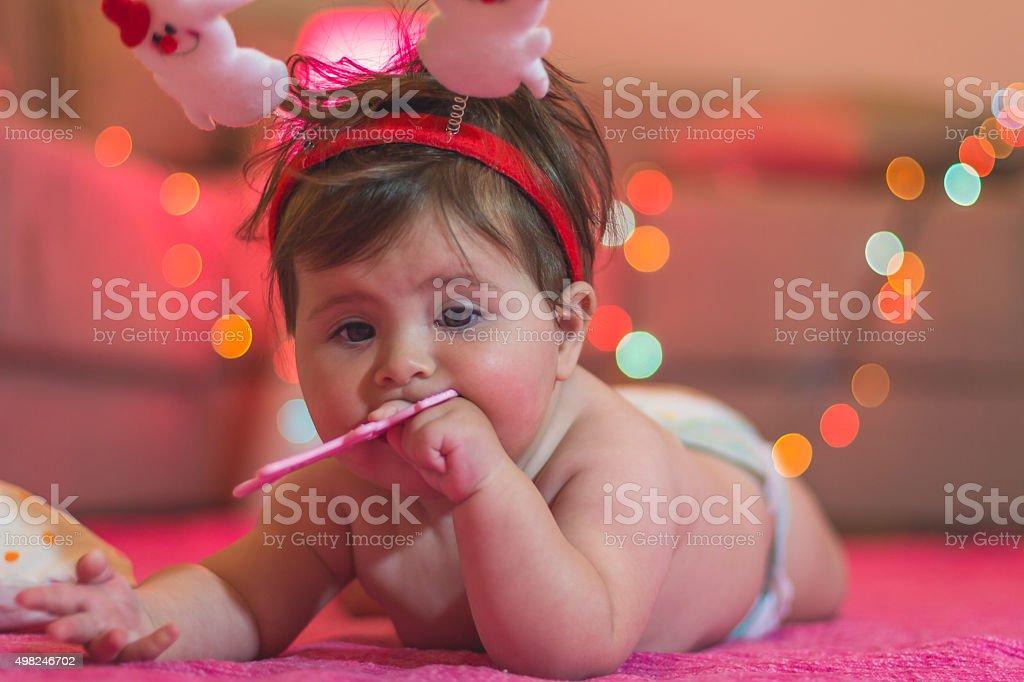 Cute Baby Girl Chews Teether On New Years Eve Stockfoto En Meer