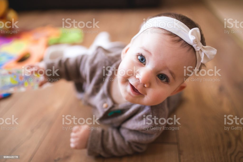 Cute Baby Girl Crawling In Living Room Adorable Baby Girl Learning How To Crawl At Her Warm Home 6-11 Months Stock Photo