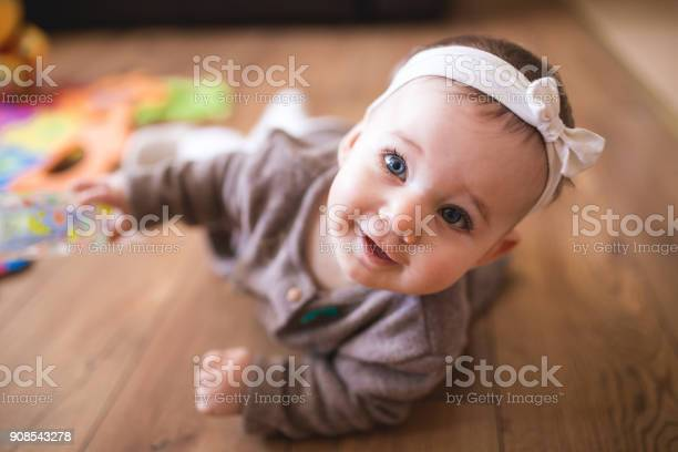 Cute baby girl crawling in living room picture id908543278?b=1&k=6&m=908543278&s=612x612&h=7adg pvc1juppeank3lyqjnsjn8bmom2kyi1vsrfbuq=