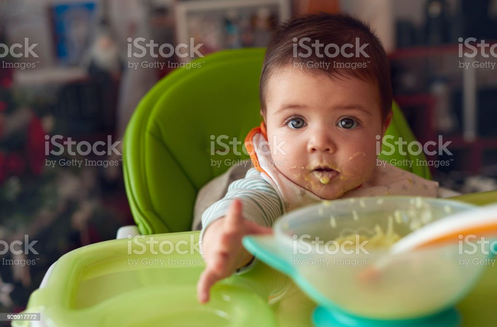 cute baby girl eating stock photo