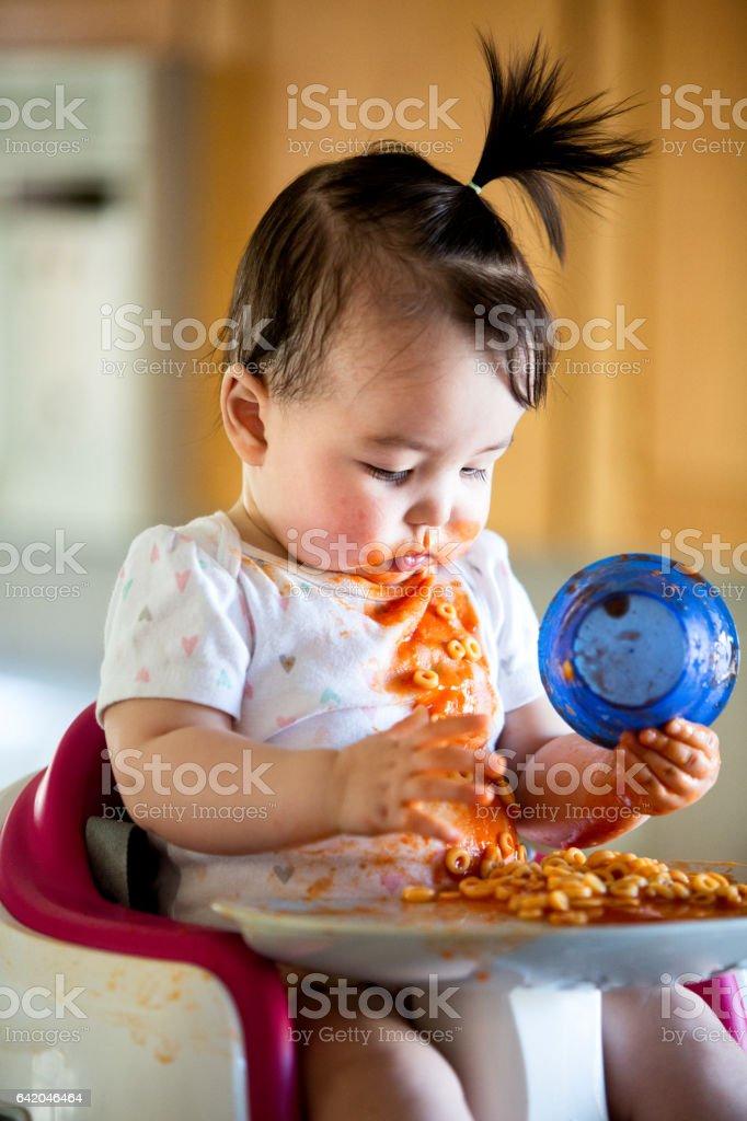 Cute Baby Girl Eating Spaghetti stock photo