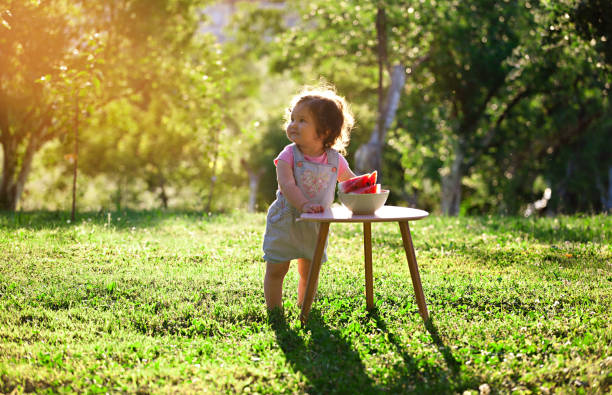 cute baby girl eating watermelon - tamara dragovic stock photos and pictures