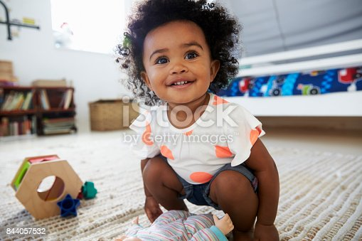 istock Cute Baby Girl Having Fun In Playroom With Toys 844057532