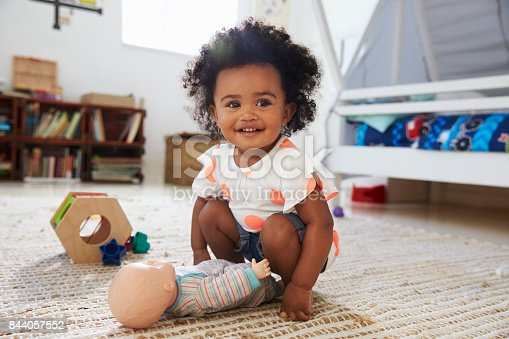 istock Cute Baby Girl Having Fun In Playroom With Toys 844057552