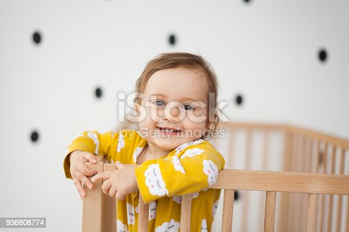 istock cute baby girl in baby crib 936808774