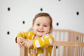 cute baby girl in baby crib