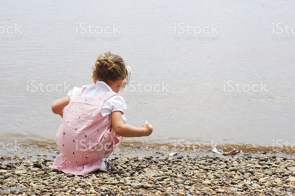 cute baby girl is exploring nature royalty-free stock photo