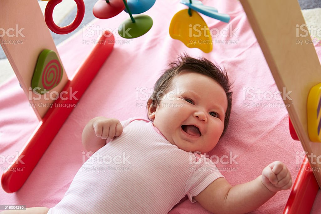 Cute Baby Girl Laying On Pink Blanket Playing With Mobile Stock Photo Download Image Now Istock