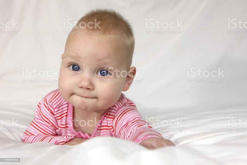 Cute Baby Girl Lying On Front stock photo