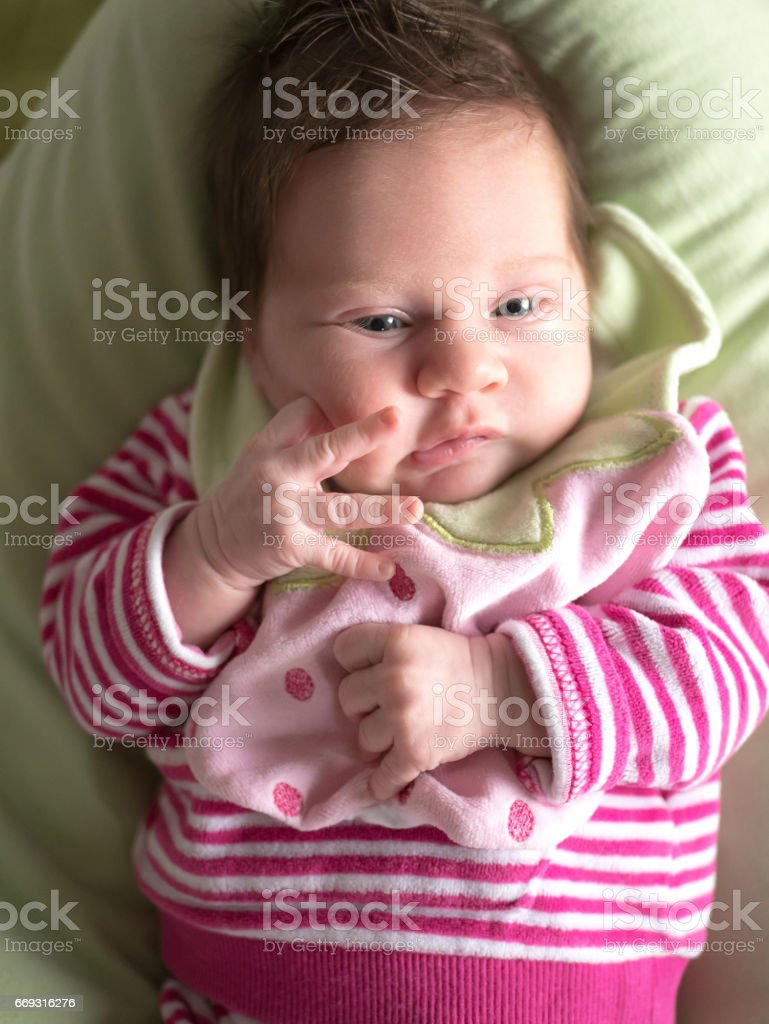 cute baby girl lying on green pillow stock photo & more pictures of