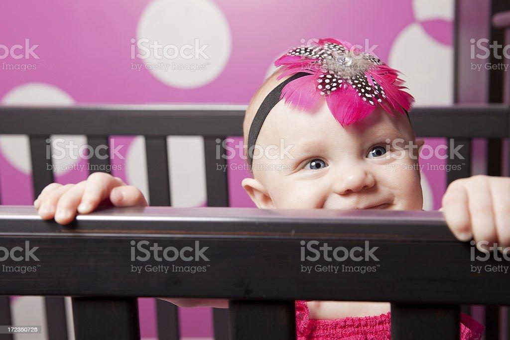 Cute Baby Girl Peeking Out of Crib royalty-free stock photo