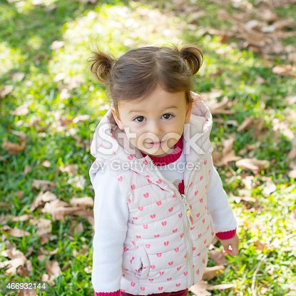 istock Cute baby girl playing at park 466932144