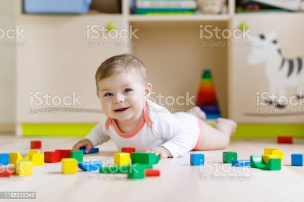 Cute baby girl playing with colorful rattle toys picture id1165312042?b=1&k=6&m=1165312042&s=612x612&h=cvqtjn6aavcrvgl nv4s x xdgxbvc1oqibn9jtpagi=