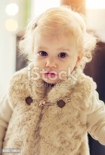 istock Cute baby girl posing on fancy clothes 639279804