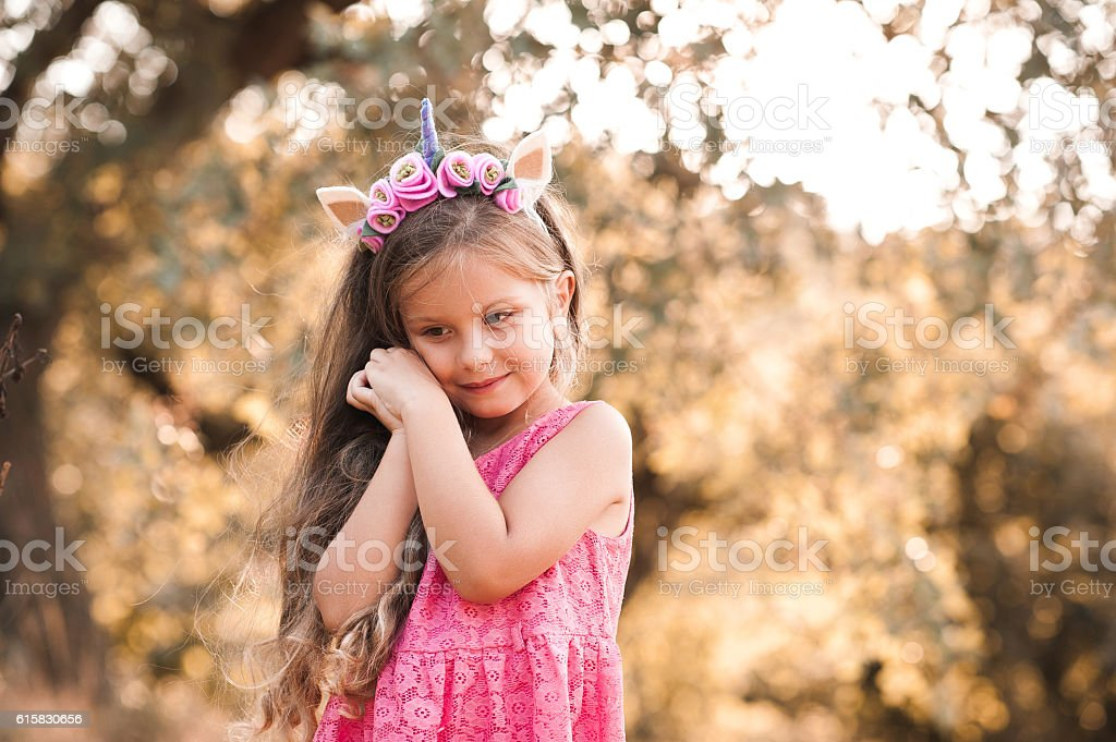 Cute baby girl posing outdoors stock photo