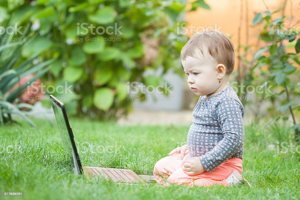 Cute baby girl using a laptop - Royalty-free 12-17 Months Stock Photo