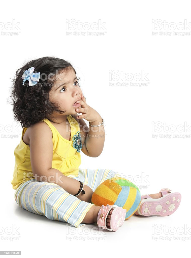 Cute baby girl with finger in mouth royalty-free stock photo