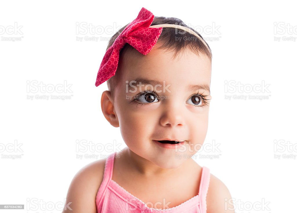 Cute baby girl with headband and smiling - foto de stock