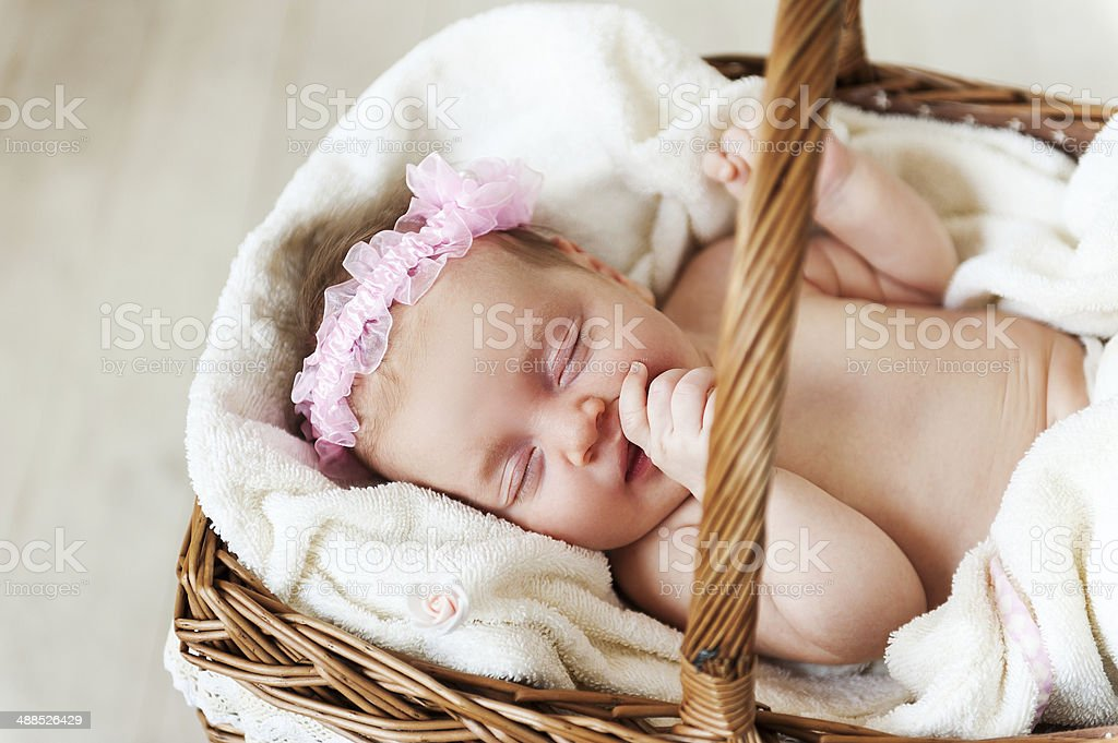 Cute baby in a wicked basket. royalty-free stock photo