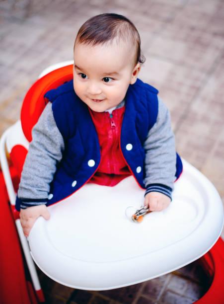 Cute baby in baby walker stock photo