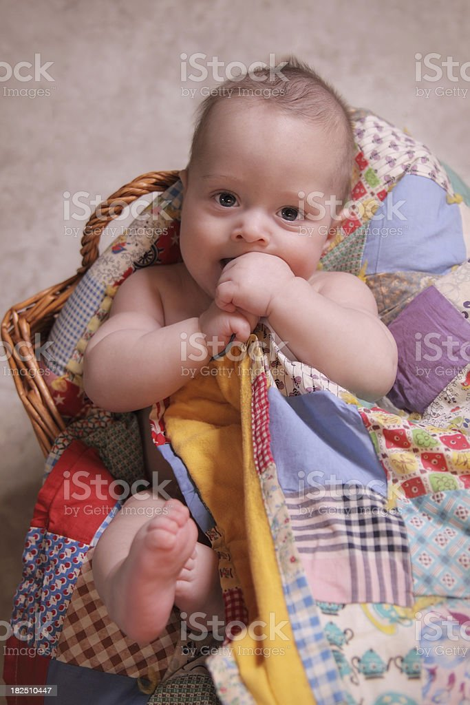 Cute Baby in basket with quilt royalty-free stock photo