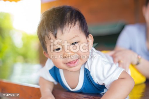 1084486306 istock photo Cute baby in bed smiling and looking at camera. 824283612