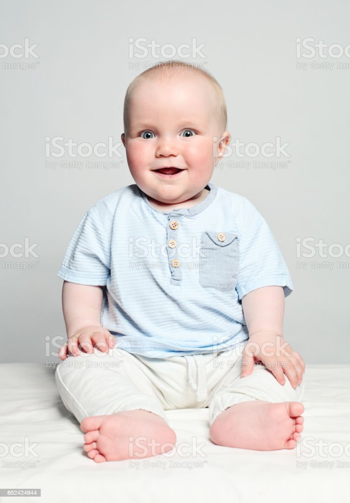84916e16eda Cute Baby In Blue Cloth Smiling Child 6 Month Old Stock Photo   More ...