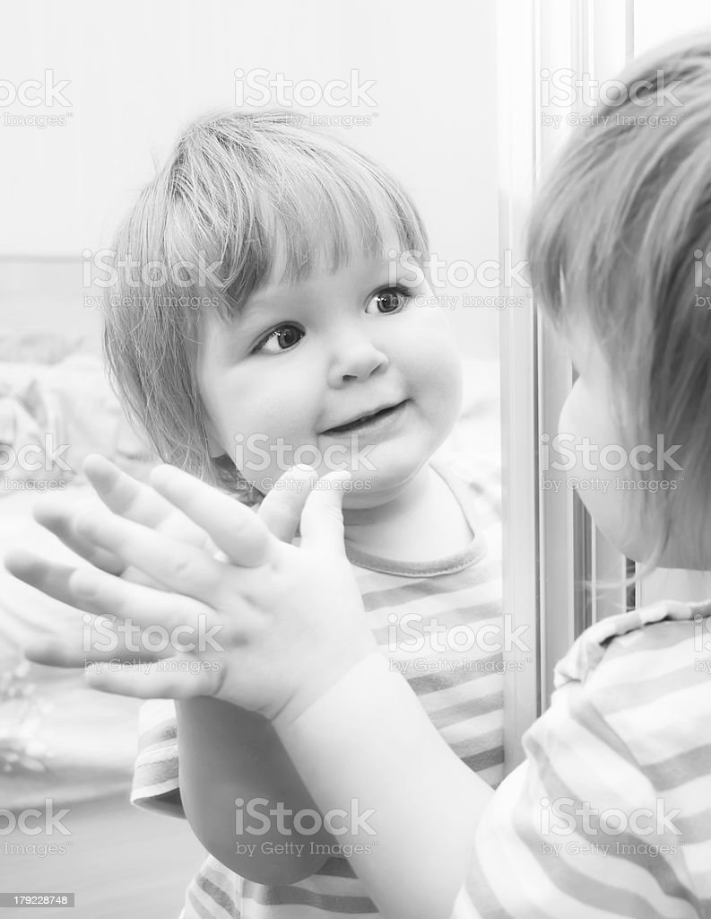 Cute baby in mirror. Black and White image. royalty-free stock photo
