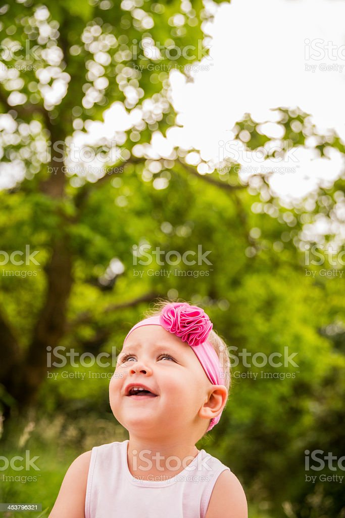 Cute baby looking at copy space in nature royalty-free stock photo