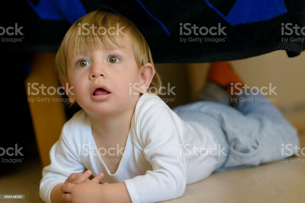 Cute Baby Looking Curious stock photo