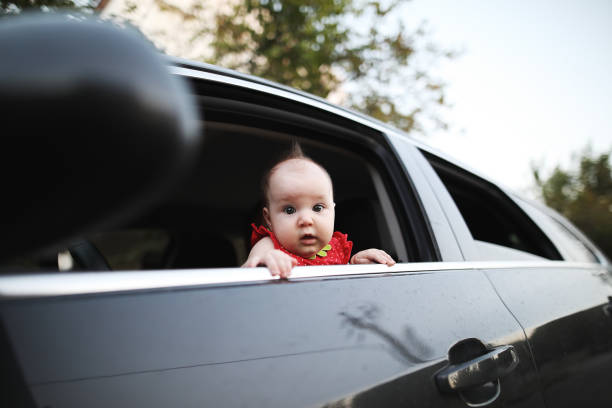 Cute baby looking Cute baby looking bonnet stock pictures, royalty-free photos & images