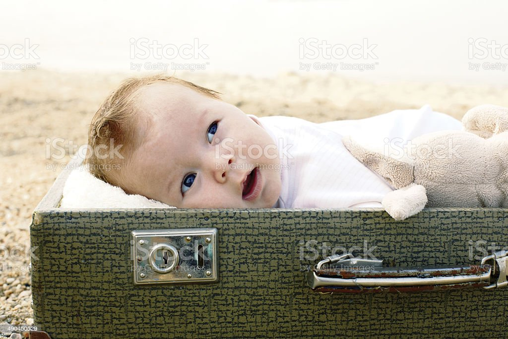 Cute baby lying in a suitcase stock photo