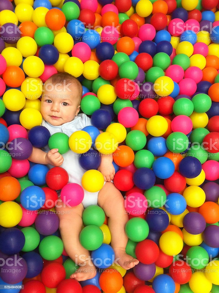 Cute baby on ball pool stock photo
