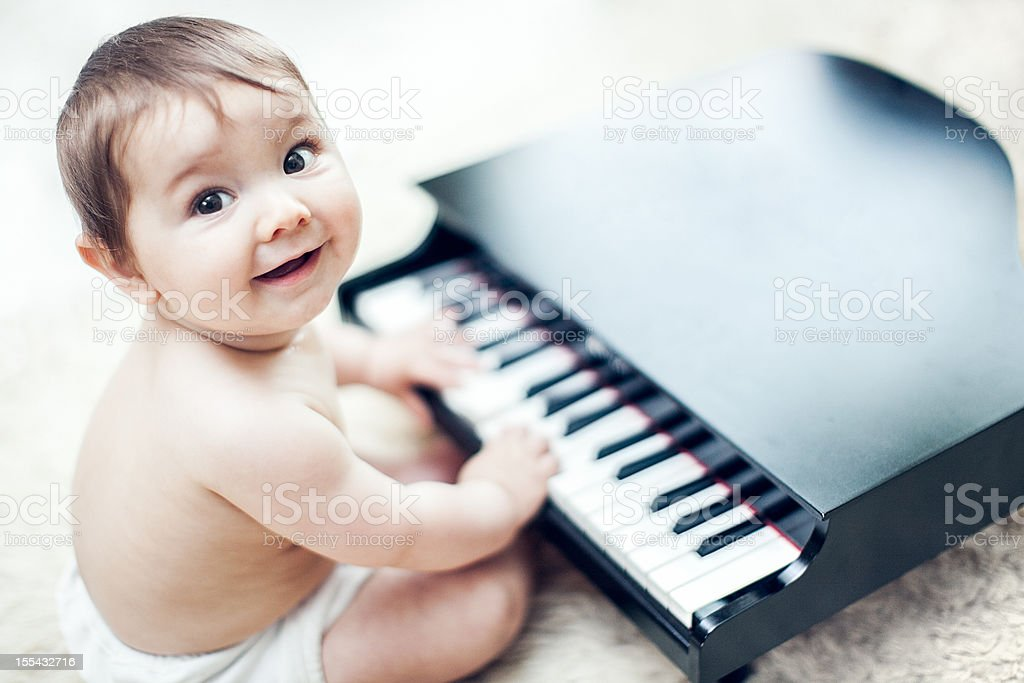 Cute Baby Playing Grand Piano stock photo