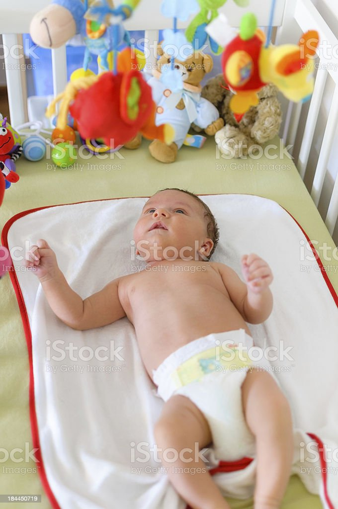 Cute baby playing in bed royalty-free stock photo