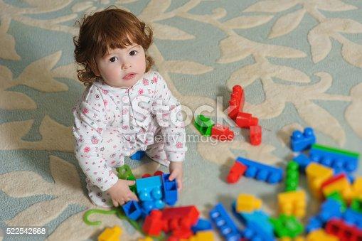 istock Cute baby playing on floor. 522542668