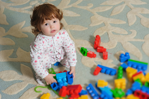 istock Cute baby playing on floor. 522542668