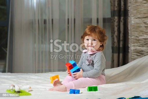 istock Cute baby playing 584789534