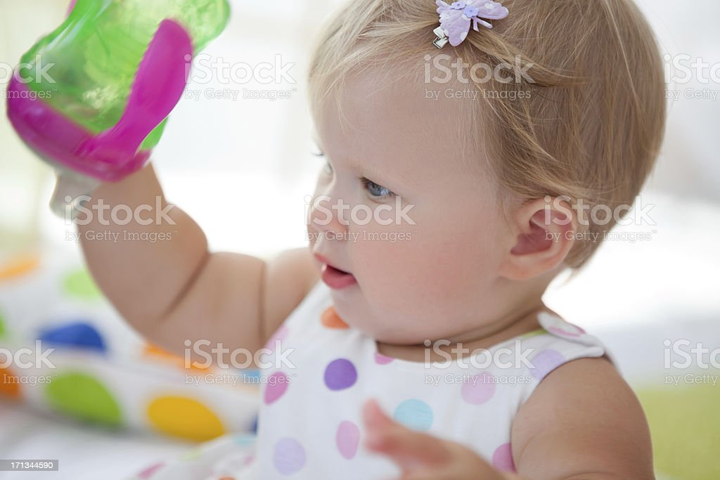 Cute baby playing with cup. royalty-free stock photo