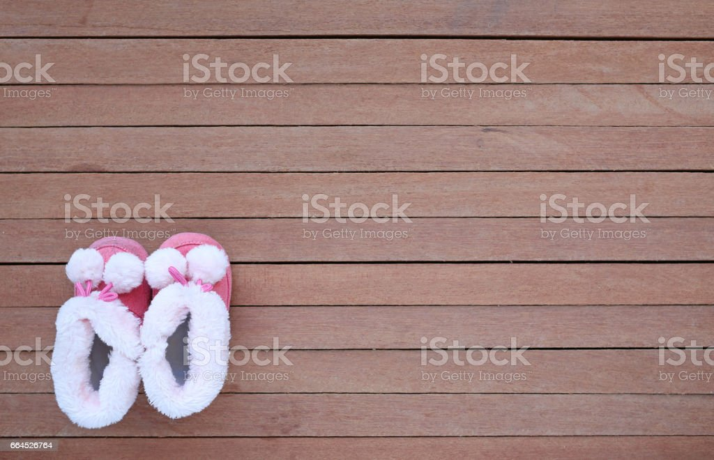 Cute baby shoes on wood plank. royalty-free stock photo