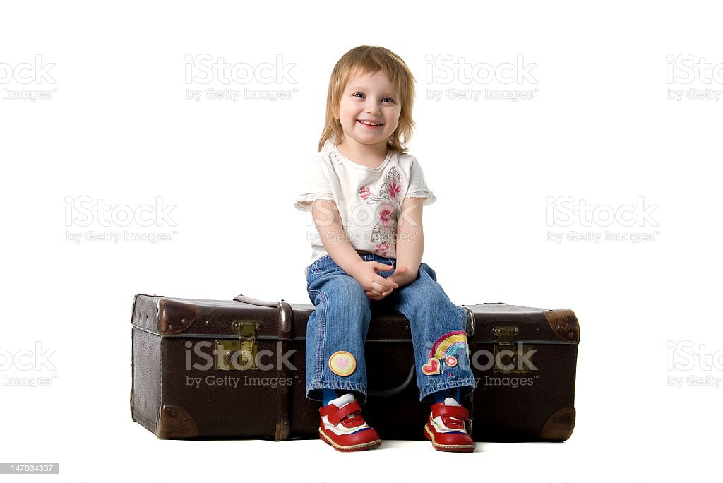 Cute baby sitting in a old suitcase royalty-free stock photo