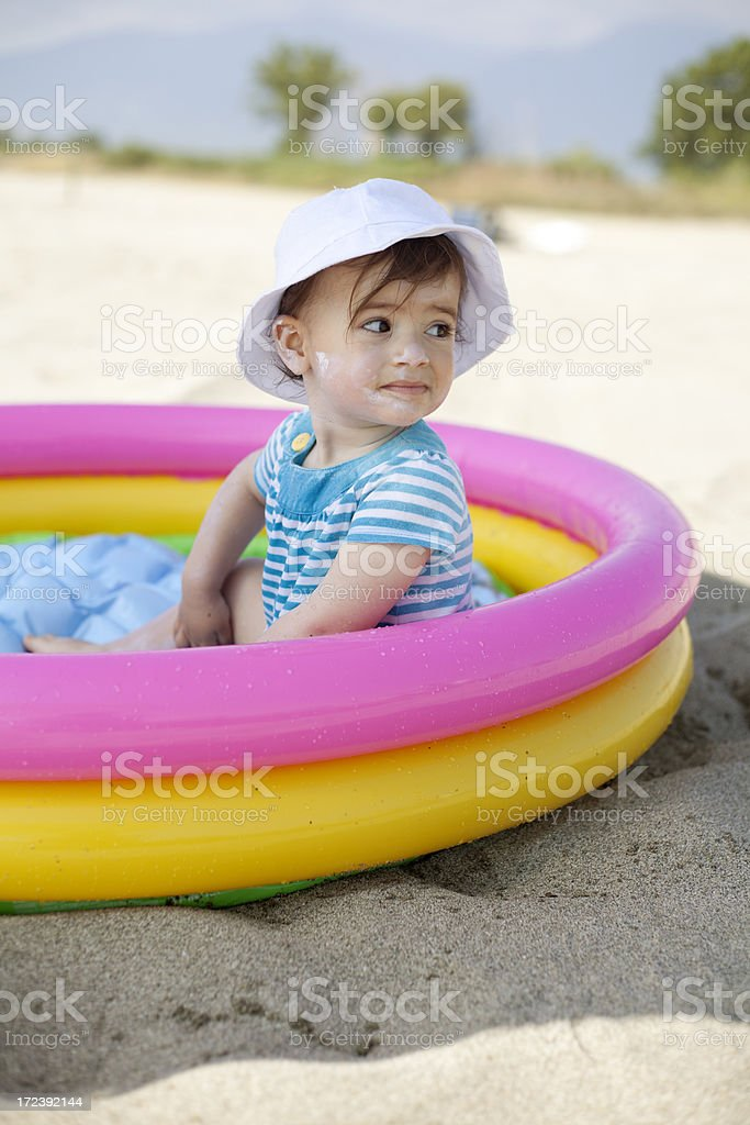 cute baby sitting in plastic pool royalty-free stock photo