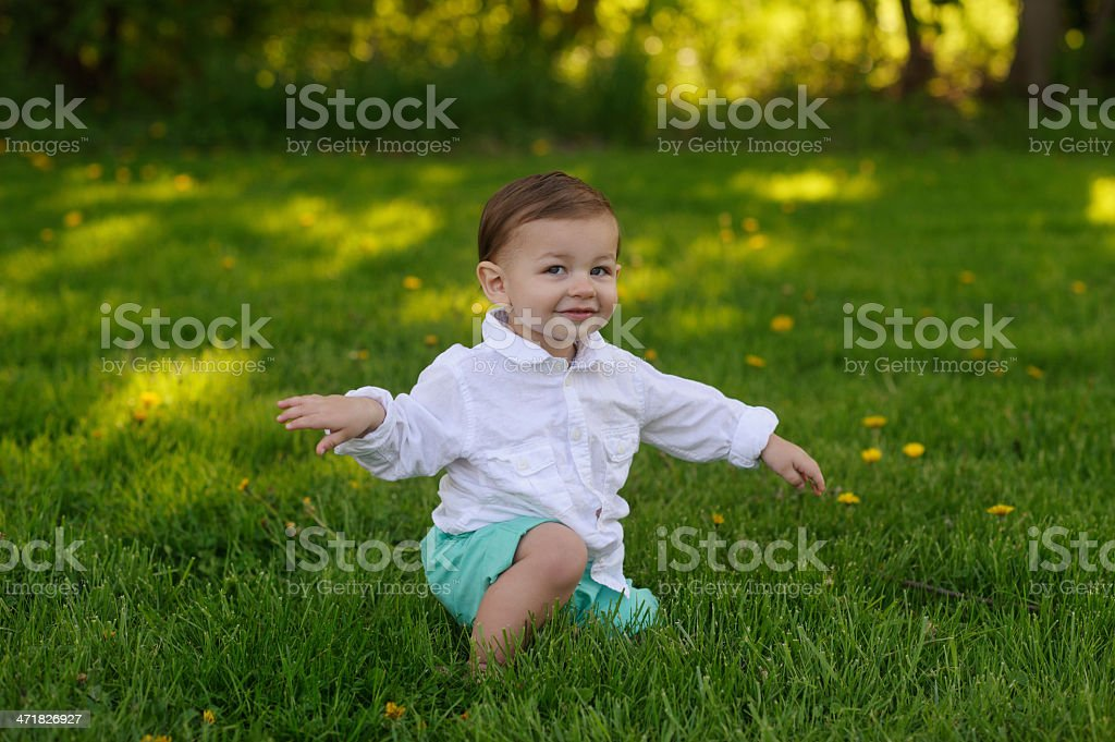 Cute Baby Sitting on Grass royalty-free stock photo