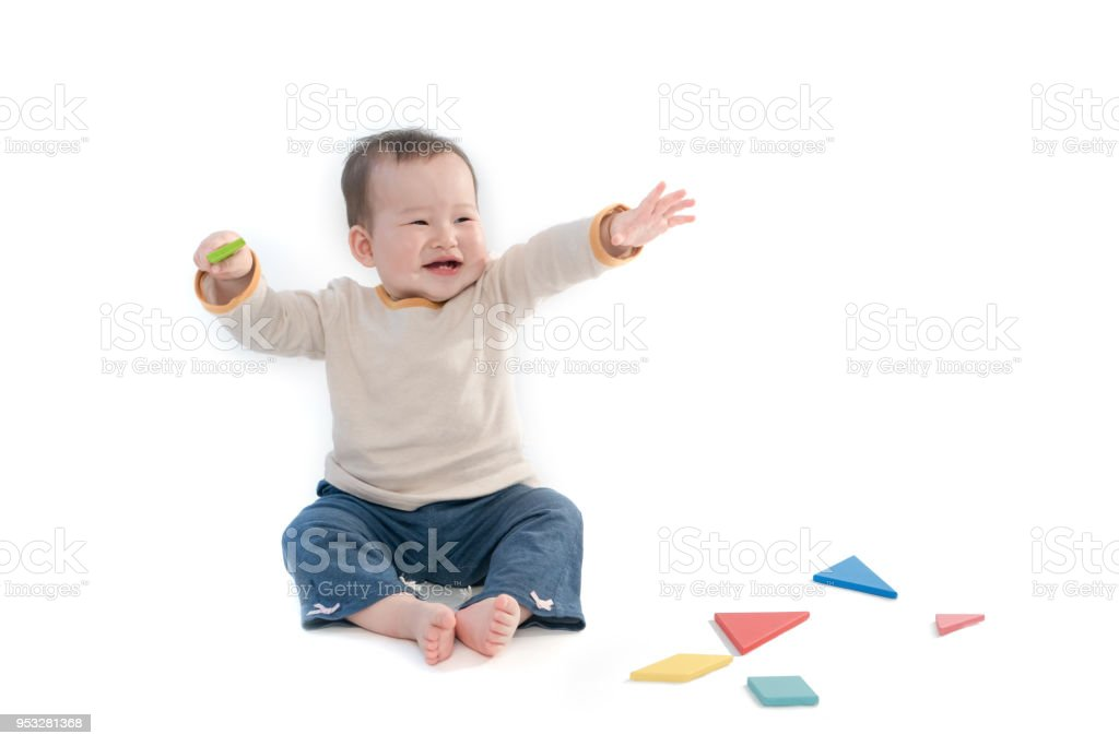 cute baby sitting playing with color models in white background royalty free stock photo