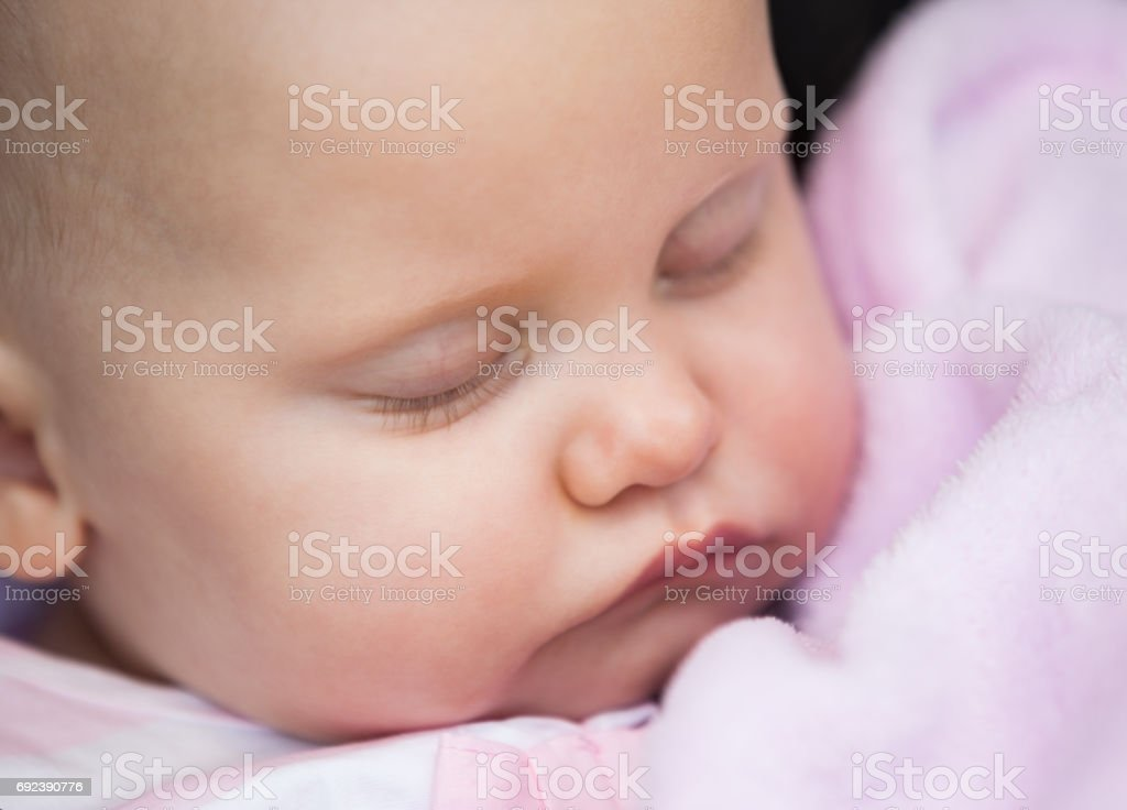 Cute baby sleeping with eyes closed stock photo