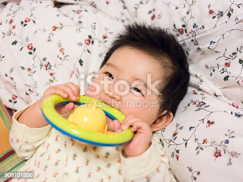 Cute baby smiling close-up Holding a toy