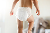 Cute baby using diapers