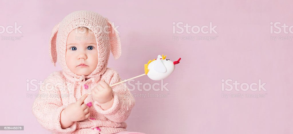 Cute baby with blue eyes in costume of Easter bunny. stock photo